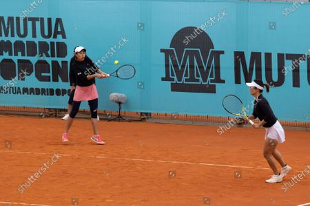 (210503) - MADRID, May 3, 2021 (Xinhua) - China's Zhang Shuai (L)/Xu Yifan competing women's double 2nd round between Zhang Shuai/Xu Yifan of China and Canada's Sharon Fichman/Mexico's Giuliana Olmos at Madrid Open in Caja a Majica in Madrid, Spain, May 3, 2021.