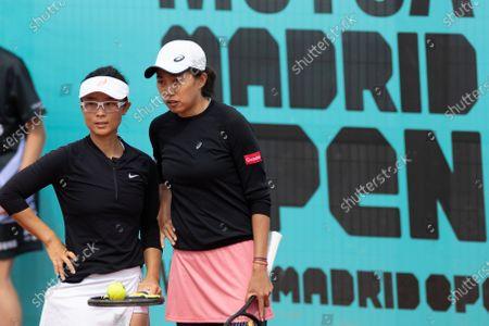 (210503) - MADRID, May 3, 2021 (Xinhua) - China's Zhang Shuai (R)/Xu Yifan communicate during the women's double 2nd round between Zhang Shuai/Xu Yifan of China and Canada's Sharon Fichman/Mexico's Giuliana Olmos at Madrid Open in Cajun a Majica in Madrid, Spain, May 3, 2021.