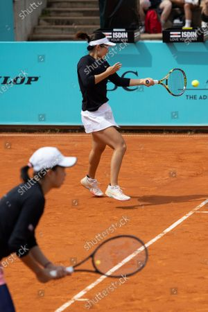 Stock Image of (210503) - MADRID, May 3, 2021 (Xinhua) - China's Zhang Shuai/Xu Yifan (top) competing women's doubles 2nd round between Zhang Shuai/Xu Yifan of China and Canada's Sharon Fichman/Mexico's Giuliana Olmos at Madrid Open in Caja a Majica in Madrid, Spain, May 3, 2021.