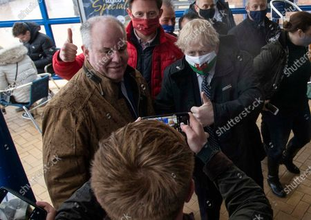 Prime Minister Boris Johnson with Welsh Conservative Leader Andrew RT Davies whilst visiting MarcoÕs cafe in Barry Island, South Wales on Bank Holiday Monday.