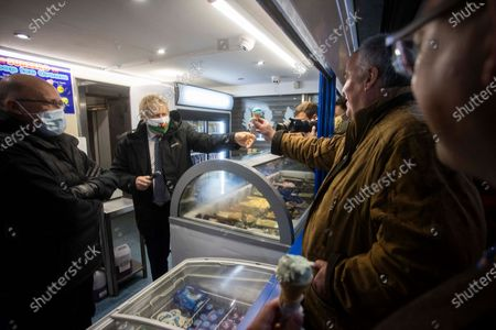 Prime Minister Boris Johnson serving ice cream to Welsh Conservative Leader Andrew RT Davies whilst visiting MarcoÕs cafe in Barry Island, South Wales on Bank Holiday Monday.