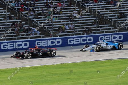 Will Power leads Graham Rahal during an IndyCar Series auto race at Texas Motor Speedway, in Fort Worth, Texas