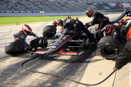 The pit crew of Will Power works during an IndyCar Series auto race at Texas Motor Speedway, in Fort Worth, Texas
