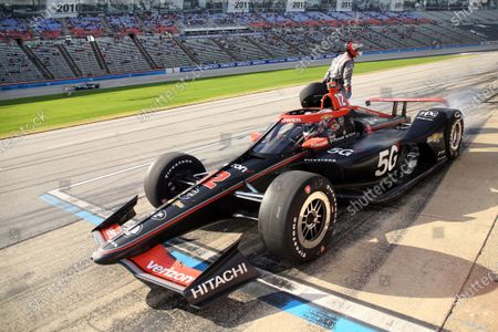 Stock Image of Will Power peels out of the pit area during an IndyCar Series auto race at Texas Motor Speedway, in Fort Worth, Texas