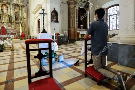 A man prays before the relic of the Holy Cross of Christ, in the Metropolitan Cathedral of Asuncion, Paraguay, 03 May 2021. The Metropolitan Cathedral of Asuncion exhibited the relic of the Holy Cross, two wood chips belonging to the cross on which Jesus Christ died, according to Catholic tradition, which arrived in Paraguay in 1556 with the Spanish bishop Pedro Fernandez de la Torre, as a gift from Pope Paul IV.
