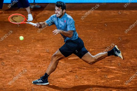 Christian Garin of Chile in action against Fernando Verdasco of Spain during their first round match at the Mutua Madrid Open tennis tournament at La Caja Magica tennis complex in Madrid, Spain, 03 May 2021.