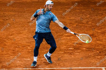 Fernando Verdasco of Spain in action against Christian Garin of Chile during their first round match at the Mutua Madrid Open tennis tournament at La Caja Magica tennis complex in Madrid, Spain, 03 May 2021.
