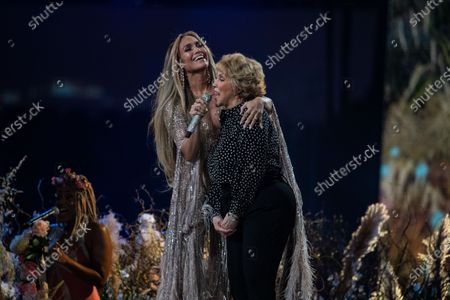 Stock Picture of Jennifer Lopez performs with her mom, Guadalupe Rodriguez, at the Vax Live concert at SoFi Stadium on Sunday, May 2, 2021 in Inglewood, CA. (Jason Armond / Los Angeles Times)