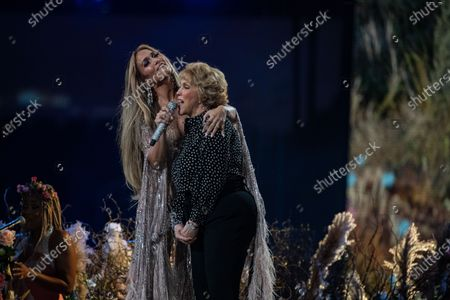 Stock Photo of Jennifer Lopez performs with her mom, Guadalupe Rodriguez, at the Vax Live concert at SoFi Stadium on Sunday, May 2, 2021 in Inglewood, CA. (Jason Armond / Los Angeles Times)