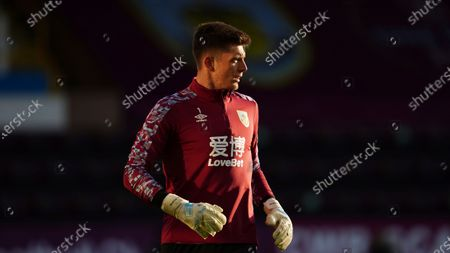Burnley's goalkeeper Nick Pope warms up ahead of the English Premier League soccer match between Burnley and West Ham United and at Turf Moor stadium in Burnley, England