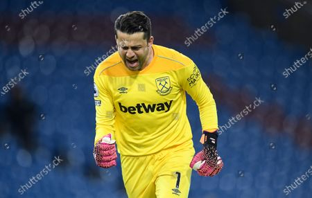 West Ham's goalkeeper Lukasz Fabianski celebrates after his teammate West Ham's Michail Antonio scored his sides 2nd goal of the game during the English Premier League soccer match between Burnley and West Ham United and at Turf Moor stadium in Burnley, England