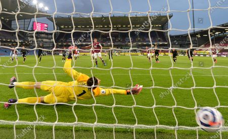 Burnley's Chris Wood, at centre score the opening goal of the game past a diving West Ham's goalkeeper Lukasz Fabianski during the English Premier League soccer match between Burnley and West Ham United and at Turf Moor stadium in Burnley, England