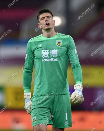 Burnley's goalkeeper Nick Pope reacts as his side miss a chance to score a goal during the English Premier League soccer match between Burnley and West Ham United and at Turf Moor stadium in Burnley, England