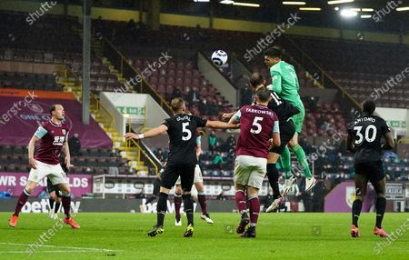 Burnley's goalkeeper Nick Pope heads the ball towards goal in the closing moments of the English Premier League soccer match between Burnley and West Ham United and at Turf Moor stadium in Burnley, England, . Westb Ham won the game 2-1