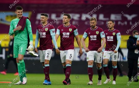 Burnley's goalkeeper Nick Pope, left walks with his teammates onto the pitch just prior to kick off of the English Premier League soccer match between Burnley and West Ham United and at Turf Moor stadium in Burnley, England
