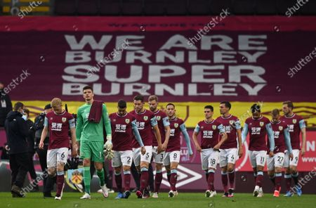 Burnley's goalkeeper Nick Pope, second left walks with his teammates onto the pitch just prior to kick off of the English Premier League soccer match between Burnley and West Ham United and at Turf Moor stadium in Burnley, England