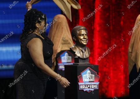 Stock Image of Cydney Nunn unveils the bust of her grandfather Bill Nunn during the Pro Football Hall of Fame Enshrinement ceremony in Canton, Ohio