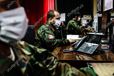 Intelligence officers monitor aerial footages from surveillance aircrafts and make necessary decisions at the Operations Intelligence Center in Kabul, Afghanistan, Wednesday, April 28, 2021. (MARCUS YAM / LOS ANGELES TIMES)