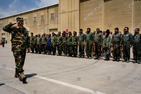 Chief of General Staff of the Armed Forces Gen. Mohammad Yasin Zia, left, salutes members of the 777 Special Mission Wing during a visit at their base in Kabul, Afghanistan, Wednesday, April 28, 2021. (MARCUS YAM / LOS ANGELES TIMES)