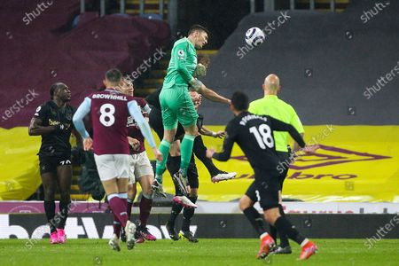 Burnley goalkeeper Nick Pope (1) heads the ball on goal from the corner kick during the Premier League match between Burnley and West Ham United at Turf Moor, Burnley