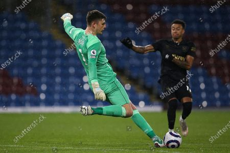 Burnley goalkeeper Nick Pope (1) lears from the onrushing West Ham United midfielder Jesse Lingard (11) during the Premier League match between Burnley and West Ham United at Turf Moor, Burnley