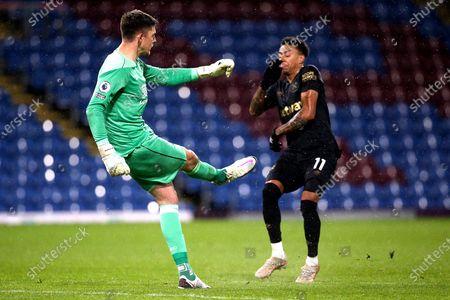 Burnley goalkeeper Nick Pope (1) and West Ham United midfielder Jesse Lingard (11) during the Premier League match between Burnley and West Ham United at Turf Moor, Burnley