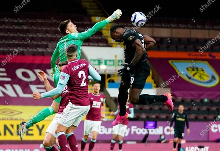 Burnley's goalkeeper Nick Pope (L) in action against West Ham's Michail Antonio (R) during the English Premier League soccer match between Burnley FC and West Ham United in Burnley, Britain, 03 May 2021.