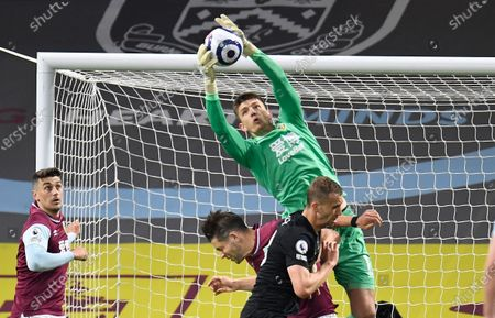 Burnley's goalkeeper Nick Pope (up) clears the ball during the English Premier League soccer match between Burnley FC and West Ham United in Burnley, Britain, 03 May 2021.
