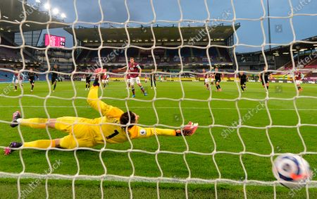 Burnley's Chris Wood (C) scores the 1-0 lead from the penalty spot against West Ham's goalkeeper Lukasz Fabianski (front) during the English Premier League soccer match between Burnley FC and West Ham United in Burnley, Britain, 03 May 2021.