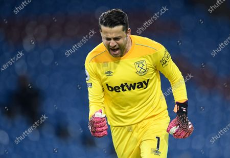 West Ham's goalkeeper Lukasz Fabianski celebrates his team's 1-1 equalizer during the English Premier League soccer match between Burnley FC and West Ham United in Burnley, Britain, 03 May 2021.