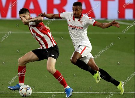 Sevilla's Fernando Francisco Reges (R) in action against Bilbao's Oihan Sancet (L) during the Spanish La Liga soccer match between Sevilla FC and Athletic Bilbao at Sanchez Pizjuan stadium in Seville, southern Spain, 03 May 2021.