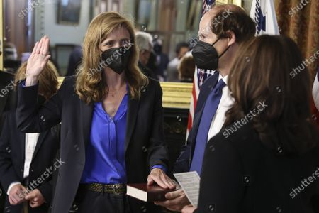 U.S. Vice President Kamala Harris, right, swears in Samantha Power, administrator of the United States Agency for International Development (USAID), alongside her husband Cass Sunstein, holding the bible, in the Eisenhower Executive Office Building in Washington, D.C., U.S., on Monday, May 3, 2021. The Senate confirmed Power, who was an ambassador to the United Nations during the Obama administration.