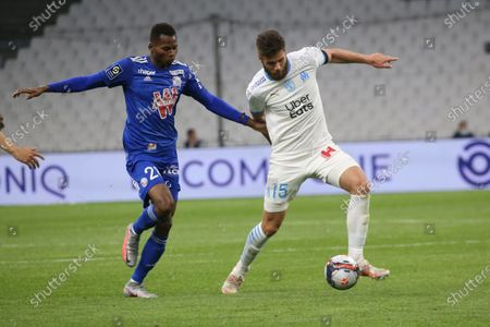 Marseille's Duje Caleta-Car fight for the ball with Strasbourg's Habib Diallo (l) during the French L1 football match between Marseille and Strasbourg at the Velodrome stadium in Marseille on April 30, 2021.