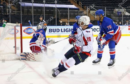 Nicklas Backstrom, center, of the Washington Capitals scores in the third period against Igor Shesterkin, left, of the New York Rangers during an NHL hockey game, in New York