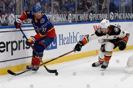 Anaheim Ducks' Cam Fowler (4) defends against St. Louis Blues' Jaden Schwartz (17) during the second period of an NHL hockey game, in St. Louis