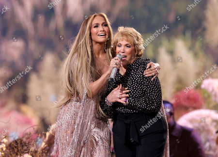 Stock Picture of (L-R) Jennifer Lopez and Guadalupe Rodriguez perform onstage during Global Citizen VAX LIVE: The Concert To Reunite The World at SoFi Stadium in Inglewood, California. Global Citizen VAX LIVE: The Concert To Reunite The World will be broadcast on May 8, 2021.