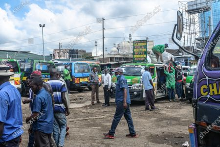 Travelers are seen loading their luggage on the inter-county buses at Machakos Bus Station in Nairobi. Addressing the Nation from State house in his full Labour Day speech, President Uhuru Kenyatta on May 1st, lifted a curb on all public transports and cross-county travels as Schools and learning institutions prepare to reopen on May 10th as per the Ministry of Education Academic Calendar. The president also extended the nation wide curfew across Nairobi, Machakos, Kajiado, Kiambu and Nakuru back to 10 pm to 4am daily for a period of 30 days.