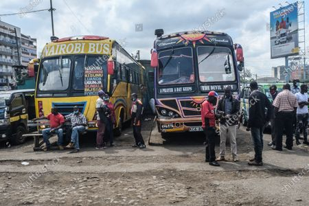 Stock Photo of Travelers wait to board their buses at Machakos Bus Station in Nairobi. Addressing the Nation from State house in his full Labour Day speech, President Uhuru Kenyatta on May 1st, lifted a curb on all public transports and cross-county travels as Schools and learning institutions prepare to reopen on May 10th as per the Ministry of Education Academic Calendar. The president also extended the nation wide curfew across Nairobi, Machakos, Kajiado, Kiambu and Nakuru back to 10 pm to 4am daily for a period of 30 days.