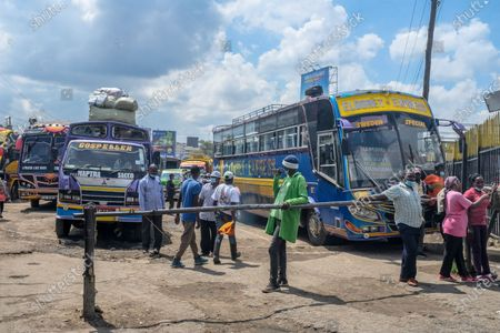 Stock Picture of Inter-county buses are seen parked at the Machakos Bus Station waiting for passengers in Nairobi. Addressing the Nation from State house in his full Labour Day speech, President Uhuru Kenyatta on May 1st, lifted a curb on all public transports and cross-county travels as Schools and learning institutions prepare to reopen on May 10th as per the Ministry of Education Academic Calendar. The president also extended the nation wide curfew across Nairobi, Machakos, Kajiado, Kiambu and Nakuru back to 10 pm to 4am daily for a period of 30 days.