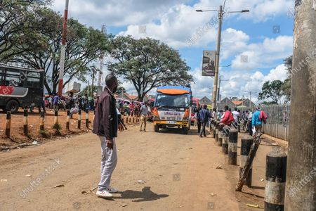 Travelers wait to board their buses at Machakos Bus Station in Nairobi. Addressing the Nation from State house in his full Labour Day speech, President Uhuru Kenyatta on May 1st, lifted a curb on all public transports and cross-county travels as Schools and learning institutions prepare to reopen on May 10th as per the Ministry of Education Academic Calendar. The president also extended the nation wide curfew across Nairobi, Machakos, Kajiado, Kiambu and Nakuru back to 10 pm to 4am daily for a period of 30 days.