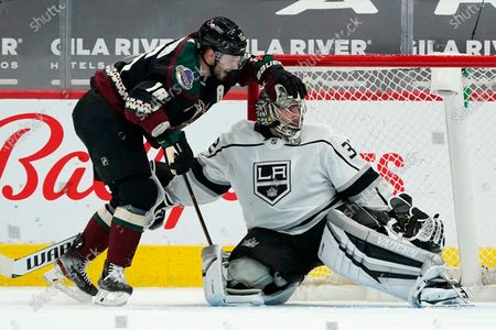 Stock Picture of Arizona Coyotes center Derick Brassard (16) uses Los Angeles Kings goaltender Jonathan Quick, right, to get up off the ice during the second period of an NHL hockey game, in Glendale, Ariz