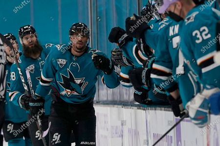 San Jose Sharks left wing Evander Kane, middle, is congratulated by teammates after scoring against the Colorado Avalanche during the second period of an NHL hockey game in San Jose, Calif