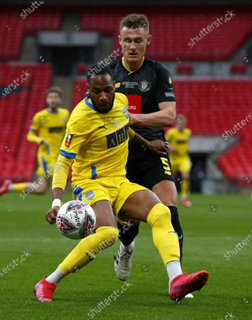 L-R Lamar Reynolds of Concord Rangers holds of Will Smith of Harrogate Town during  The 2019/2020 Buildbase FA Trophy Final between Concord Rangers and Harrogate Town at Wembley Stadium on 03rd May , 2021 in London, England