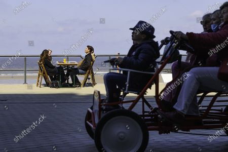 Stock Image of Mayor of Middelkerke, Jean-Marie Dedecker, declared terraces of bars and restaurant public domain in order to bypass current Belgian covid-19 lock-down rules. Eating or drinking on a terrace is still forbidden, doing the same on public domain is not