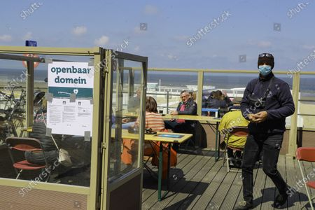 Mayor of Middelkerke, Jean-Marie Dedecker, declared terraces of bars and restaurant public domain in order to bypass current Belgian covid-19 lock-down rules. Eating or drinking on a terrace is still forbidden, doing the same on public domain is not