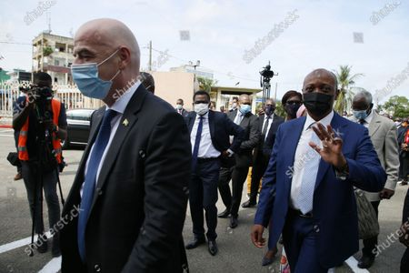 FIFA President Gianni Infantino (L) and African Football Confederation (CAF) President Patrice Motsepe (R) arrive at the headquarters of the Ivorian Football Federation (FIF) in Abidjan, Ivory Coast, 04 May 2021. FIFA President Infantino and his CAF President Motsepe are in Abidjan for a working visit.