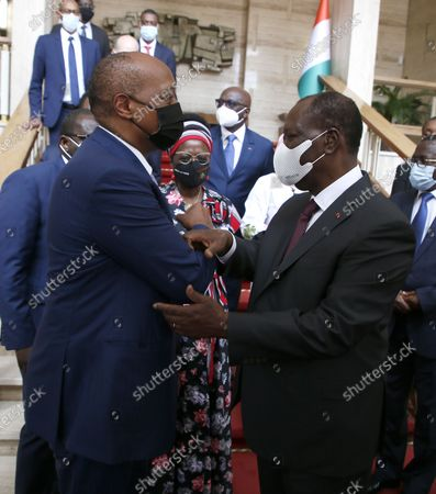 Ivorian President Alassane Ouattara (R) talks with the President of the African Football Confederation (CAF), Patrice Motsepe (L) at the presidential palace in Abidjan, Ivory Coast, 04 May 2021. FIFA President Infantino and CAF President Motsepe are in Abidjan for a working visit.