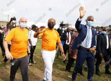 Stock Picture of The president of the International Federation of Association Football (FIFA) Gianni Infantino (L), CAF president Patrice Motsepe and former soccer player Didier Drogba (R) arrive to the launch of the Pan-African interschool championship in Abidjan, Ivory Coast, 04 May 2021. FIFA President Infantino and the CAF President Motsepe are in Abidjan for a working visit.