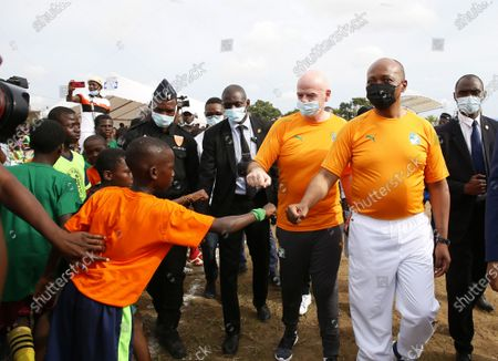 Stock Photo of The president of the International Federation of Association Football (FIFA) Gianni Infantino (3-R) and CAF president Patrice Motsepe (2-R) arrive to the launch of the Pan-African interschool championship in Abidjan, Ivory Coast, 04 May 2021. FIFA President Infantino and the CAF President Motsepe are in Abidjan for a working visit.