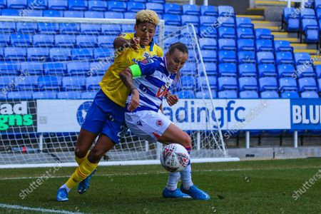 Victoria Williams (Brighton 20)pressures Natasha Harding (Reading 11) during the Barclays FA Womens Super League game between Reading and Brighton & Hove Albion at The Madejski Stadium in Reading.